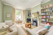 Terraced property in ST. JOHN'S HILL GROVE...