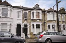 Flat to rent in Forthbridge Road, London...