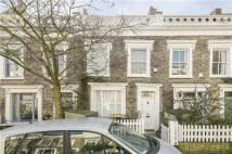 Terraced property in Quadrant Grove, London...