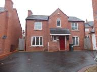Detached property to rent in Harrington Croft...