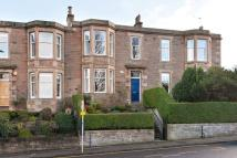 Terraced house in 19 Pentland Terrace...