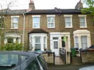 Terraced house in TRUMPINGTON ROAD, London...