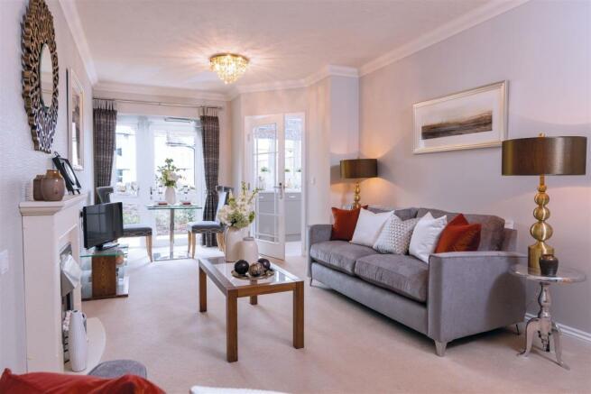 Typical 1 bed living room white windows.jpg
