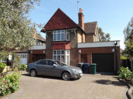 Detached house in Edgwarebury Lane