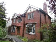 Detached home in 153 Warrington Road...