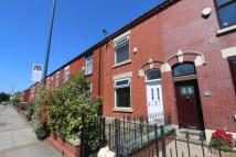 Terraced property in Stockport Road, Denton...