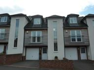 Town House in THORNEY CLOSE ROAD...
