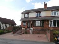 semi detached house in Tansley Hill Road...