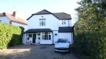 Detached home in Loddon Bridge Road...