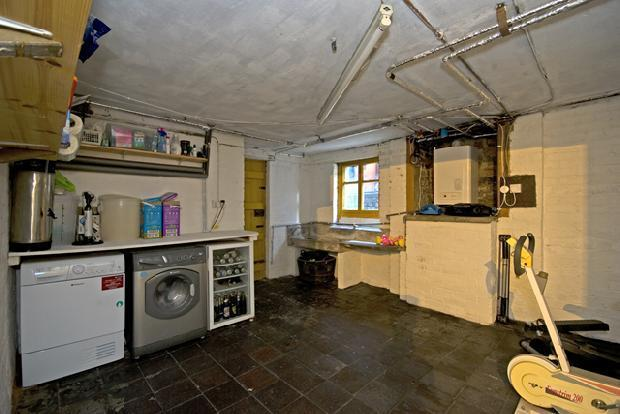 rear cellar/utility room with door leading to garden