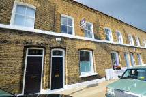 Terraced property in Quilter Street, E2