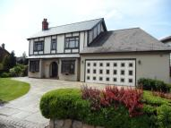 Detached house in Langleys, Henfold Road...