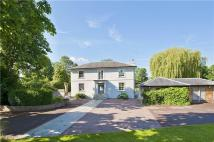 Detached house in Chertsey Road...