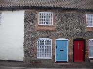 Cottage to rent in Holt