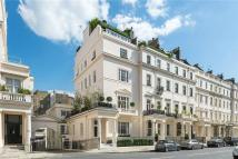 Flat in Eaton Place, London...