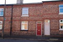 Terraced property in 15 Helmside Road...