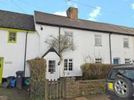 Terraced property in Summerlands Cottages...