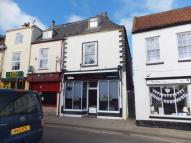 Detached property in High Street, Alford