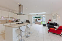 Town House in Lincoln Grove, Weybridge...