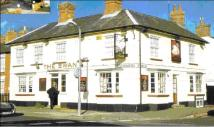 property for sale in Freehold Public House Investment at The Swan 2 Buckingham Road, Winslow, Buckinghamshire