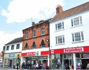 property for sale in Freehold Retail Investment Let to TATES LTD (t/a Spar)   at 15 Market Place, Lincolnshire, Louth,LN11 9PB