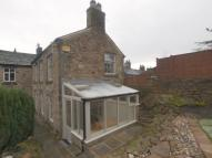 Detached property in Market Street, New Mills...
