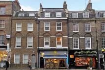 Terraced property in Grays Inn Road, London...