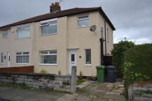 semi detached house in Woodley Road, Maghull...