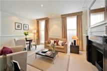 Flat in Gilbert Street, Mayfair...