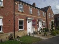 Terraced property in Doulton Close...