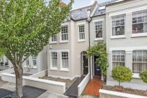 Terraced property in First Avenue, London...