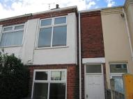 Terraced property in Castle Grove...