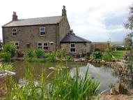 Detached house in Broomhill Farm...