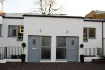 Terraced property in Cavendish Mews...