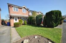 Detached property in Burrington Drive...