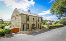 Detached home in Haslingden Old Road...