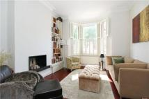 Terraced property in Priory Park Road, London
