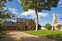 Detached property in Rectory Gardens...