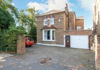 Detached house in Dorset Road, London, SW19