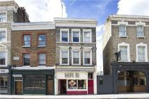Terraced property in Fulham Road, Chelsea...