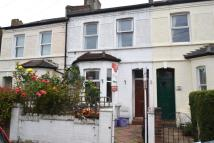 Terraced property in Cowdrey Road, Wimbledon