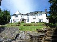 Detached home in Woodmansterne Road...