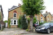 property in Munster Road, Teddington...