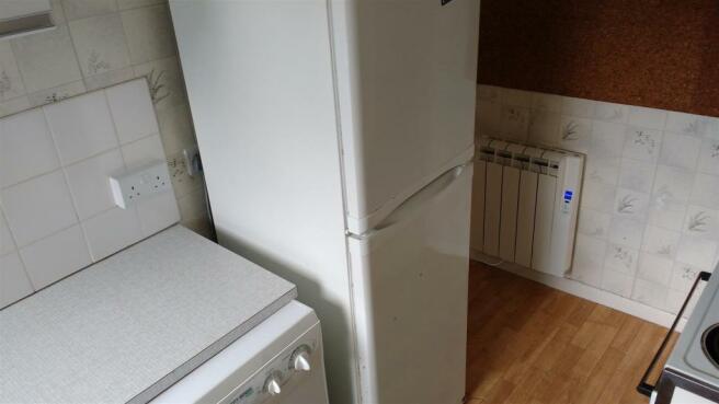 kit showing fridge a