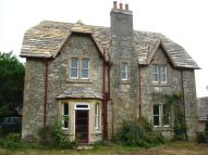 Detached property in Studland, BH19