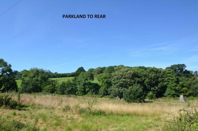 Parkland to rear