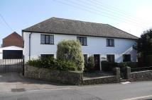 Detached house in Musbury Road, Axminster...