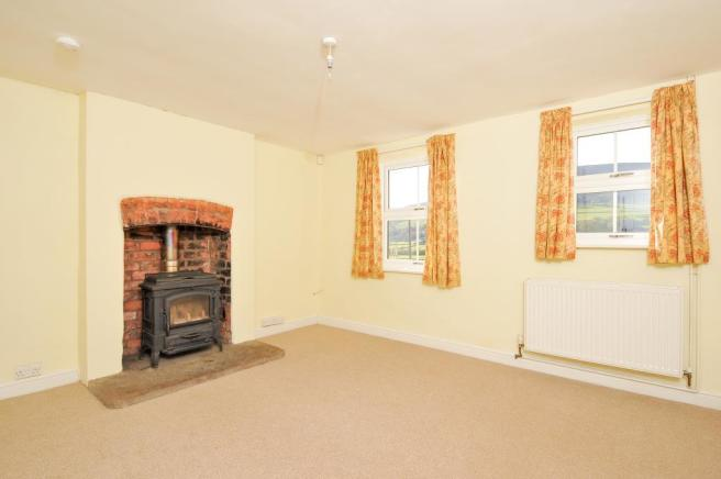 Living room with solid fuel stove