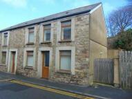 semi detached house in High Street, Ammanford...