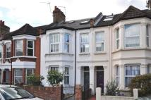 Terraced house in Eastbury Grove, London...